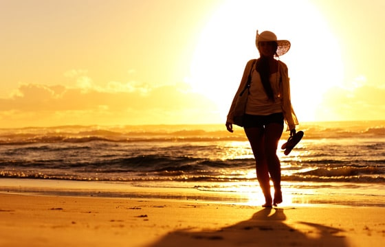 woman-beach-sunset560x360